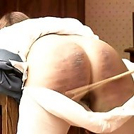 School girl shackled over her desk and relentlessly caned on her bare ass