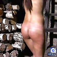 Severe outdoor whipping for a naked Beauty in historic scenery