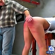 Nicky lowers her sexy skirt and gets a nasty spanking on her bare ass