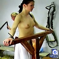 Michelle is stripped and tied to a whipping post for her terrible punishment